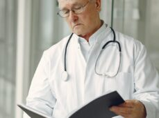 doctor-in-uniform-reading-clinical-records
