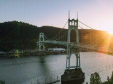 historical-suspension-bridge-over-river-at-sundown